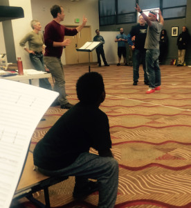 A young AAACC member took up residence next to the Maestra during rehearsal last week!